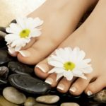 Почему происходит расслоение ногтей на ногах?